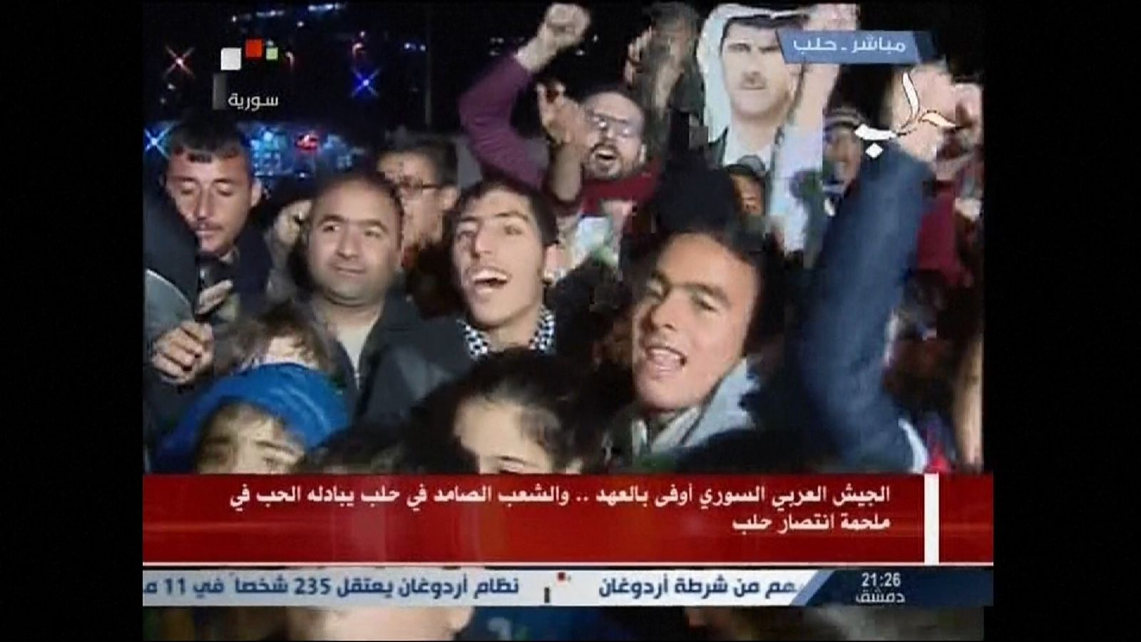 People celebrate in Aleppo