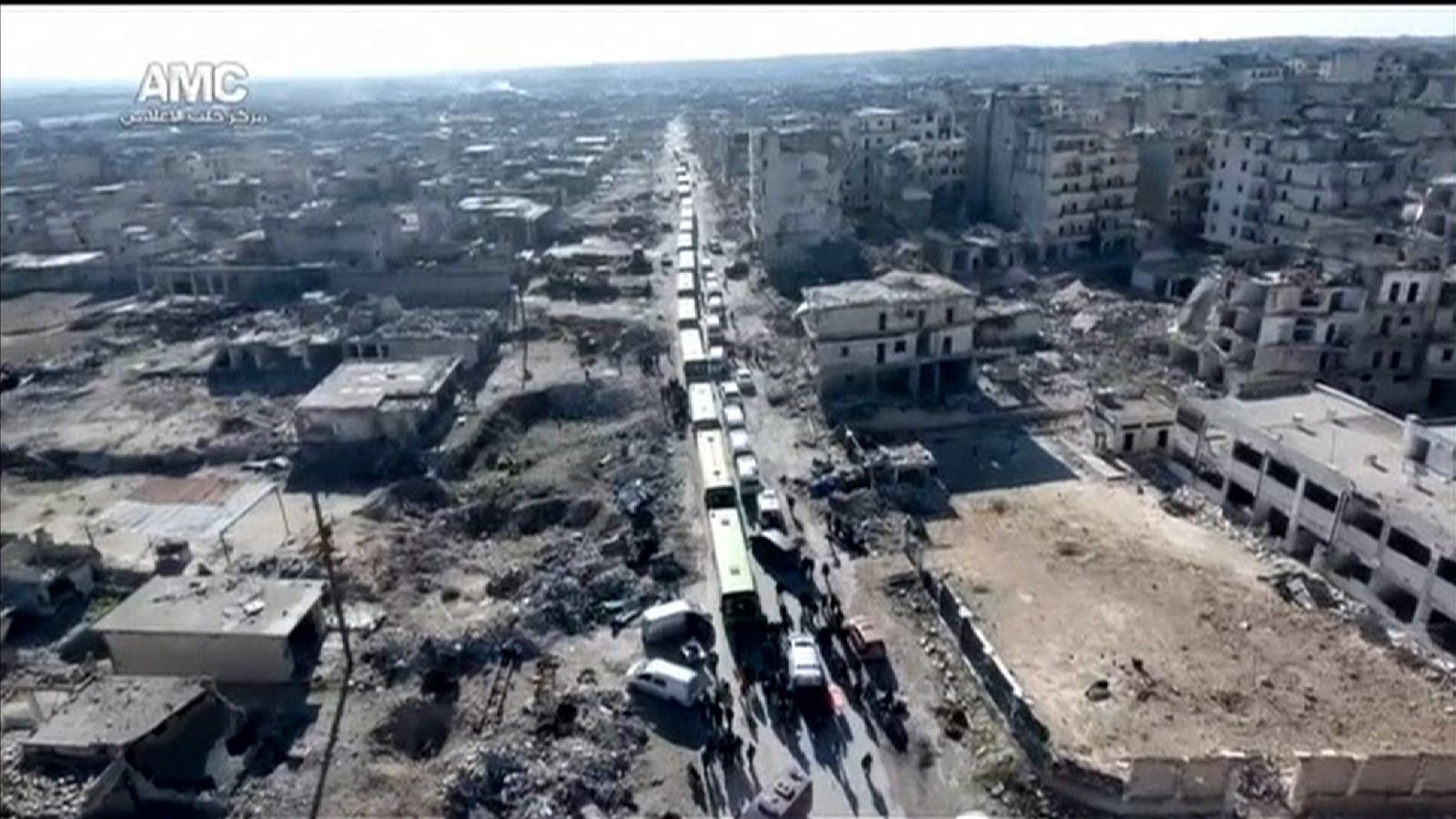 A convoy leaves Aleppo in Syria