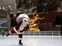 Santa Claus gets his skates on at Rockefeller Centre in Manhattan