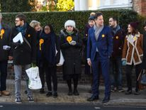 Liberal Democrat prospective parliamentary candidate, Sarah Olney (C) and former Party leader Nick Clegg (C-R) canvass ahead of the Richmond Park and North Kingston by-election on November 30, 2016 in London, England. The by-election is to take place on December 1 and was triggered by the resignation of Conservative MP Zac Goldsmith in protest at the Government's proposal for a third runway at nearby Heathrow Airport