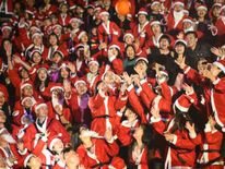 People don Santa costumes for a game in Shenzhen, Guangdong Province, China