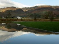 A lorry is reflected in a flooded field in Keswick in the Lake District as the flood waters that submerged large areas of Cumbria subside in 2009
