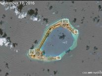 AMTI image apparently showing anti-aircraft guns on Subi Reef