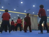 Ladies perform Tai Chi as part of the class, combining exercise and smartphone education