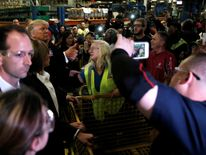 The President-elect is surrounded by factory workers