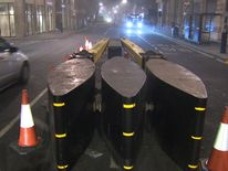 Concrete bollards will block traffic from crowds, while armed police will be on London tube trains for the first time.