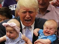Donald Trump holds two crying babies during the US election campaign.