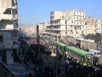 The evacuation started on the battle-scarred streets of Aleppo