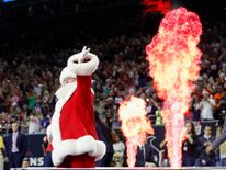 Santa is introduced before the NFL game between the Houston Texans and the Cincinnati Bengals in Houston, Texas