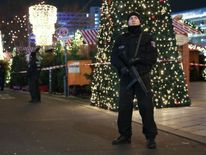 Police patrol the area where a lorry killed at least nine people at a Christmas market in Berlin