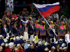 Flag bearer Sergey Tetyukhin of Russia leads his Olympic Team during the Opening Ceremony of the Rio 2016 Olympic Games