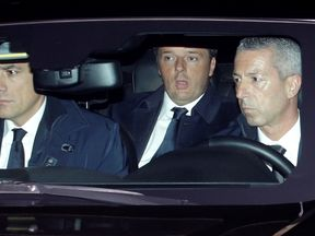 Italian Prime Minister Matteo Renzi, centre, arrives at the Presidential palace