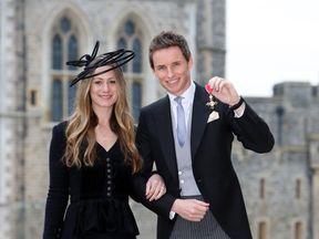 Eddie Redmayne and his wife Hannah after the investiture