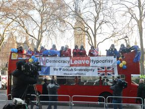 ProEU protesters on a red bus outside the Supreme Court
