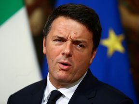 Prime Minister Matteo Renzi announces he will reseign at a news conference in Rome
