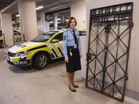 A police officer in Norway guards the gate which was found under a tarpaulin