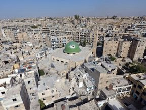 Damaged buildings and a mosque in the Old City of Aleppo, Syria