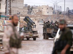 Syrian government troops in the al Haidariya neighbourhood of Aleppo