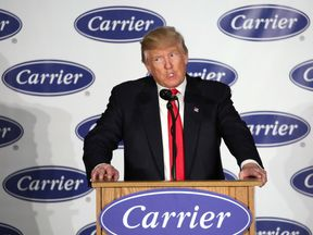 Donald Trump speaks during a visit to the Carrier plant in Indianapolis