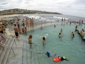 Swimmers cool off in a salt water ocean pool at Sydney's beachside suburb of Bronte