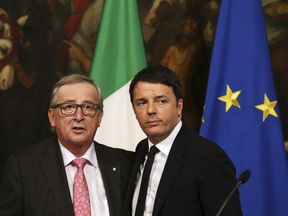 Italy's Prime Minister Matteo Renzi (R) poses with European Commission President Jean-Claude Juncker during a meeting at the Chigi Palace in Rome, Italy, February 26, 2016