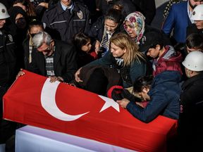 Funeral at Istanbul's police headquarters after blasts outside stadium