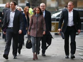 Gina Miller, escorted by bodyguards, arrives at the Supreme Court for the third day of the case
