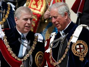 Prince Andrew and Prince Charles seen at St George's Chapel, Windsor Castle, in 2015