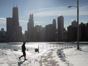 A jogger braves the cold in Chicago which is experiencing its first sub-zero temperatures this winter