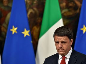 Italian Prime Minister Matteo Renzi reacts during a joint press conference with Italian Minister of Economy and Finance at Palazzo Chigi in Rome on November 28, 2016. European stock markets retreated on November 28, 2016, dragged down by falling banking stocks ahead of a crucial Italian referendum at the end of week. Tensions between Italian Prime Minister Matteo Renzi and the EU have reached a boiling point ahead of the referendum on constitutional reform on December 4, 2016