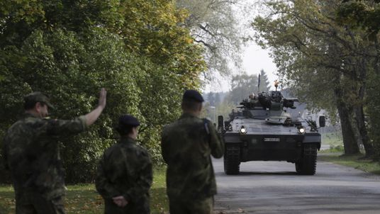 Soldiers arrive for a NATO military drill in Latvia in 2015