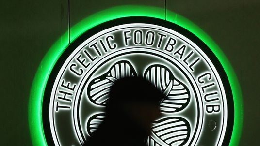 A fan walks past a Celtic logo prior to the UEFA Europa League Group A match between Celtic FC and AFC Ajax at Celtic Park on November 26, 2015