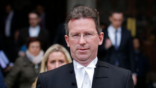 Britain's Attorney General Jeremy Wright returns to the High Court during a legal challenge to force the British government to seek parliamentary approval before starting the formal process of leaving the European Union