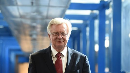 British Secretary of State for Exiting the European Union (Brexit Minister) David Davis walks along the bridge from the hotel to the International Convention Centre in Birmingham, central England, on October 2, 2016 on the first day of the Conservative party annual conference. Britain's governing Conservative Party meets for its annual conference from Sunday facing questions over how and when it will take the country out of the European Union following the Brexit vote
