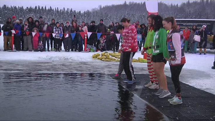 More than a thousand people in Anchorage plunged into freezing water to fundraise for the state's disabled athletes