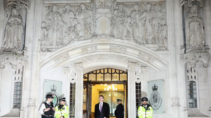 Attorney General Jeremy Wright leaves the Supreme Court
