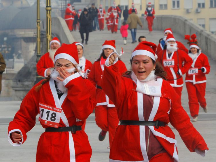 Runners dressed as Santa Claus take part in the annual Christmas race on the streets of Skopje, Macedonia