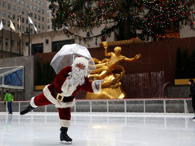 Santa Claus gets his skates on at Rockefeller Centre in Manhattan