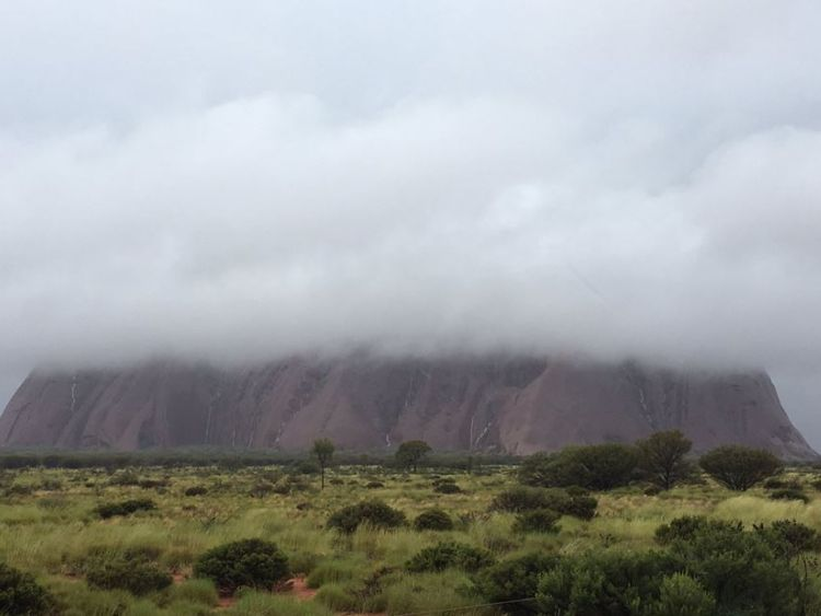 Storm clouds hang over Uluru. Pic: @BiancaH80 and @waginski