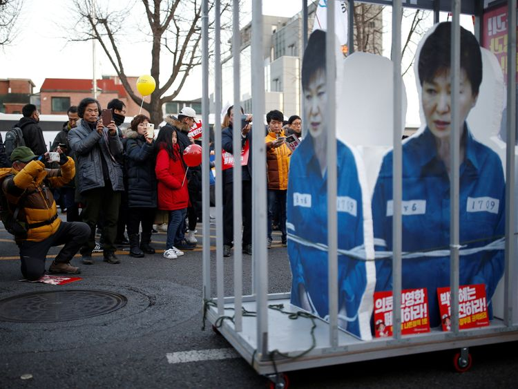 A protest in Seoul against President Park Geun-hye a day after her impeachment