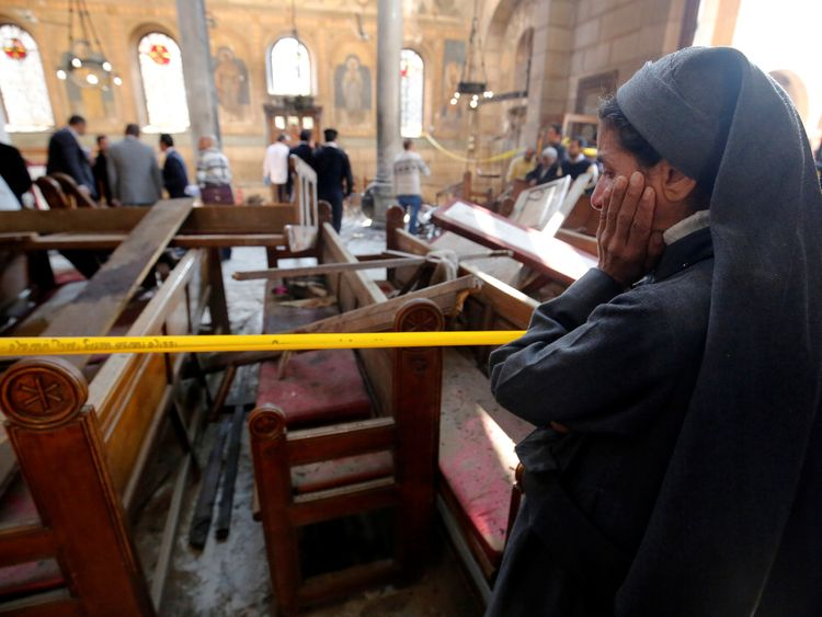 A nun surveys the scene inside the cathedral after the attack