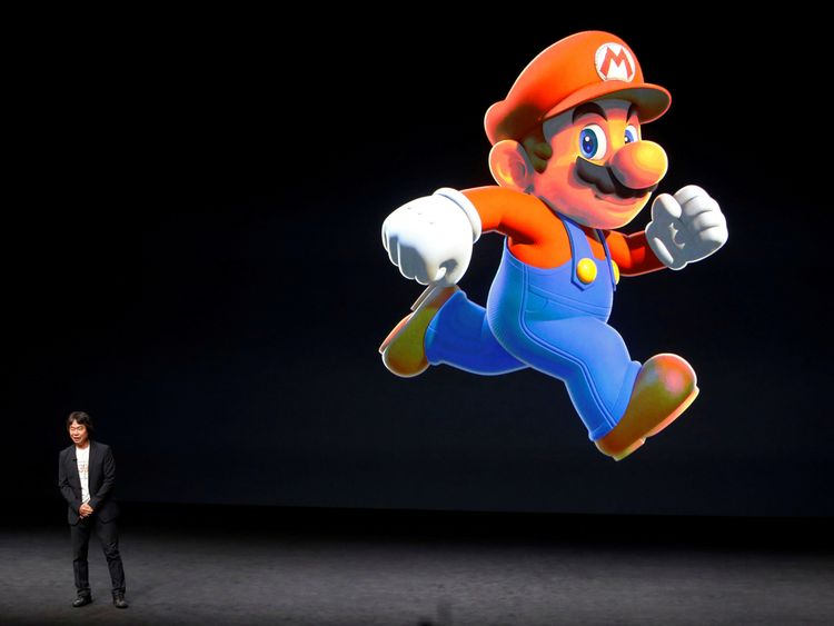 Nintendo Creative Fellow Shigeru Miyamoto stands next to the Super Mario character during an Apple media event in San Francisco, California, U.S. September 7, 2016.