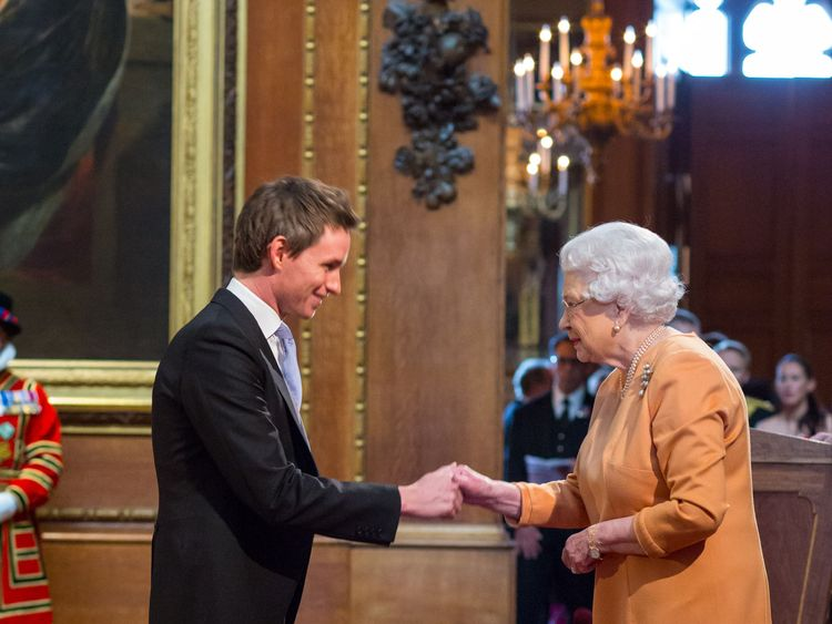 Eddie Redmayne receiving his OBE from the Queen