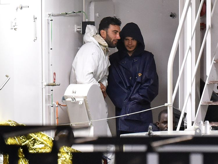 Mohammed Ali Malek and Mahmud Bikhit on an Italian Coast Guard ship
