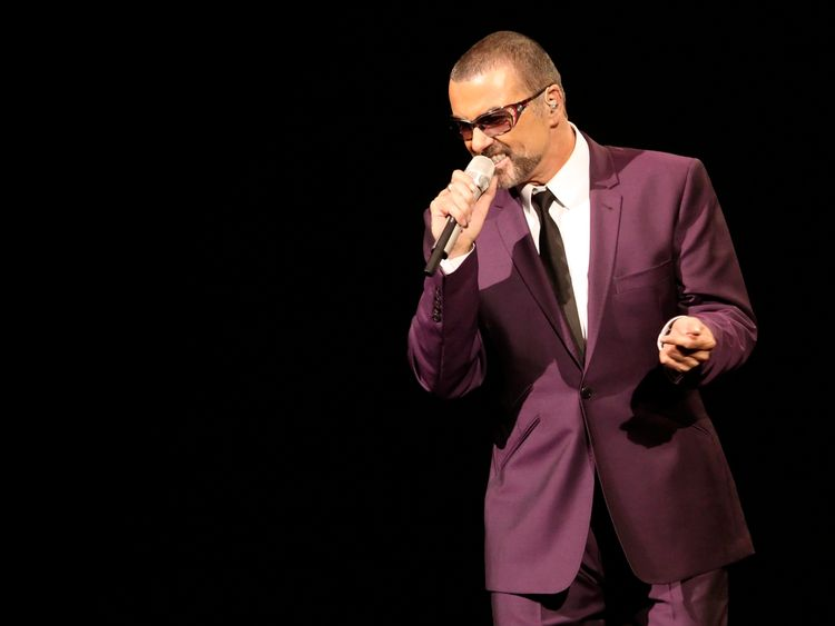 George Michael performs on stage in 2012
