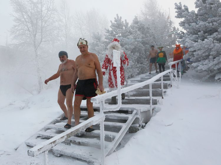 Winter swimming club members head for a dip in  Krasnoyarsk, Russia, where the air temperature is around -34C