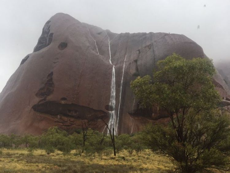 Waterfalls run down Uluru. Pic: @BiancaH80 and @waginski