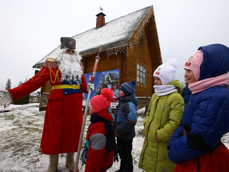 A man dressed as Father Frost, similar to Santa Claus, near the village of Goroshki, Belarus