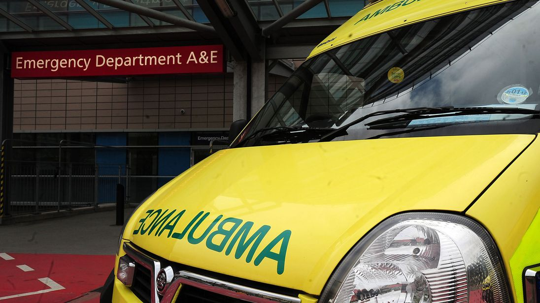 An ambulance waits outside a hospital A&E department