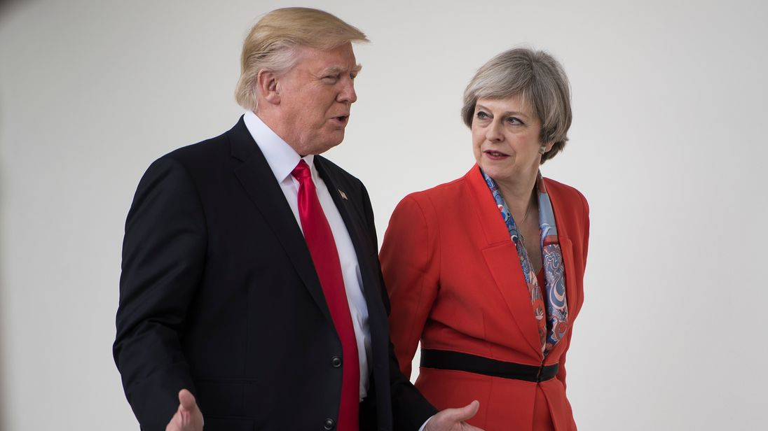 Donald Trump and Theresa May talk at the White House